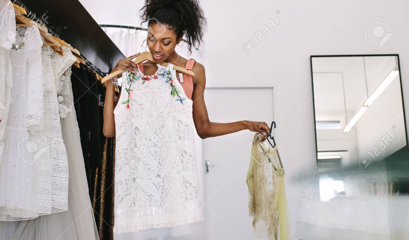 Fashion Designer Having A Look At Designer Dresses In Her Fashion Stock Photo Picture And Royalty Free Image Image 95074189