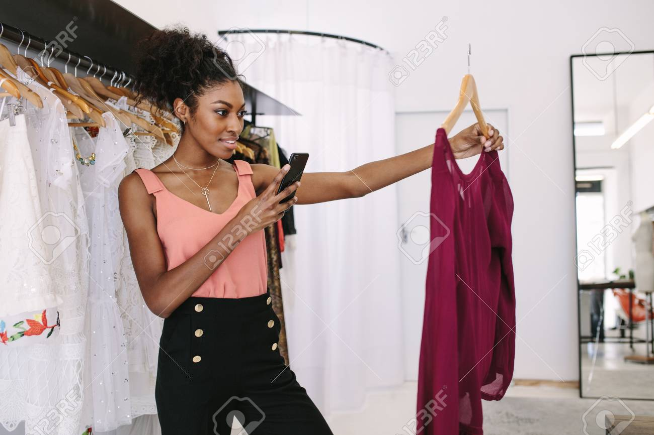 Fashion Designer Taking Photograph Of A Designer Dresses In Her Stock Photo Picture And Royalty Free Image Image 96457701