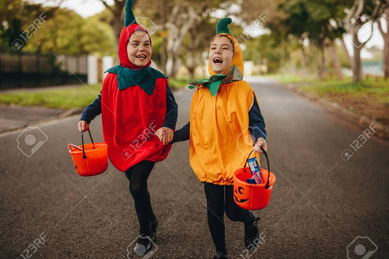 Happy Kids In Halloween Costume Trick Or Treating Outdoors Two