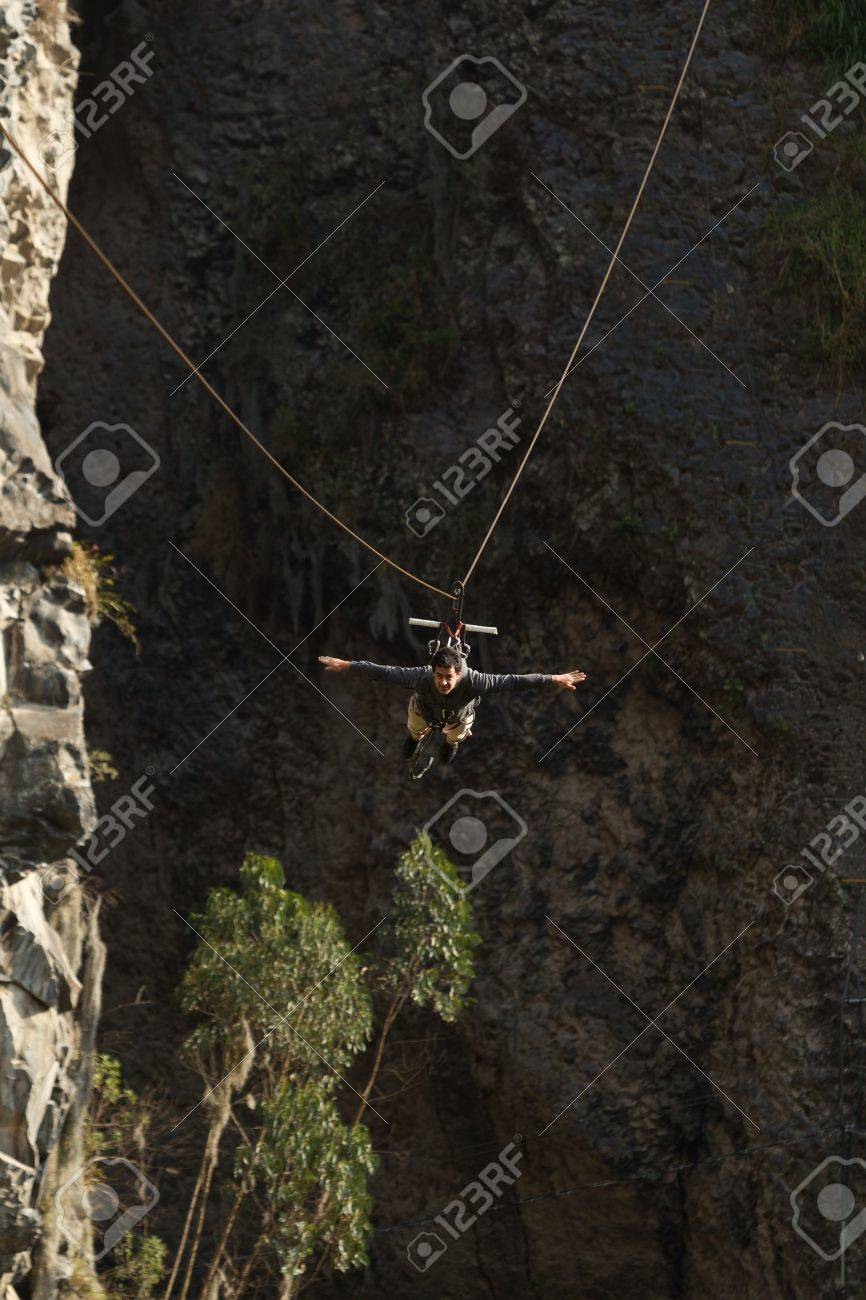 young man having fun during a zipline flight in banos de agua santa, ecuador. Stock Photo - 15970965
