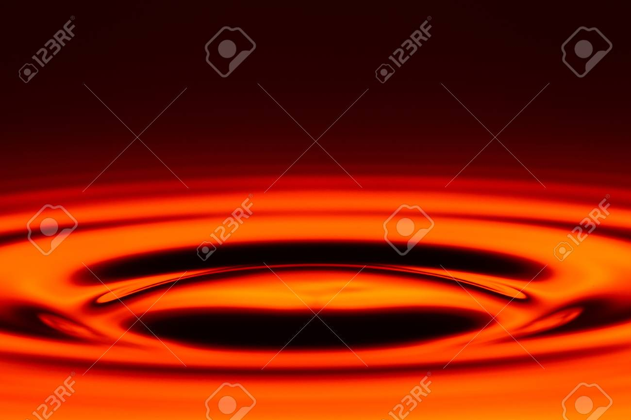 symetrical swirl from the water level against red backround Stock Photo - 17813746