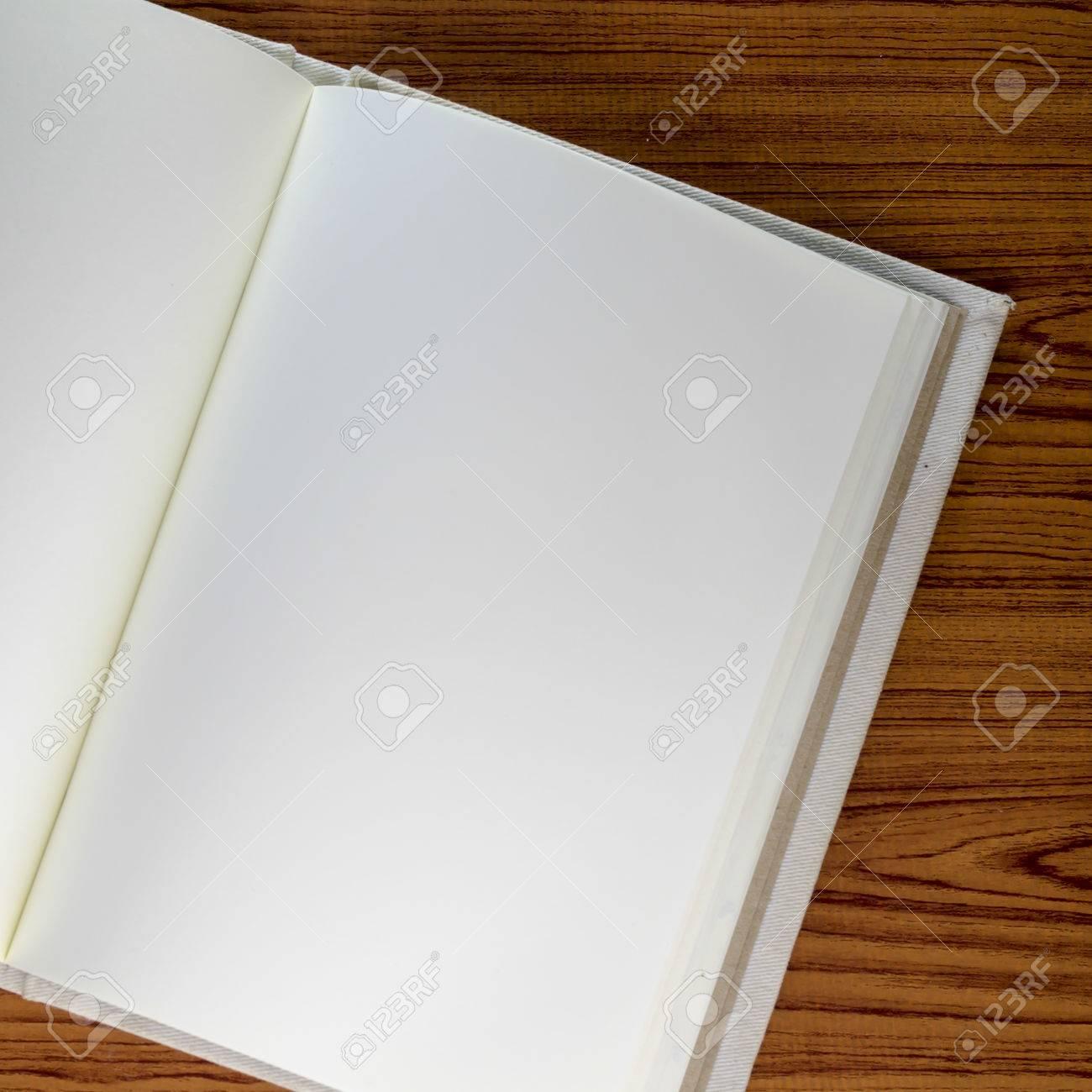 notebook on wood background Stock Photo - 26025356