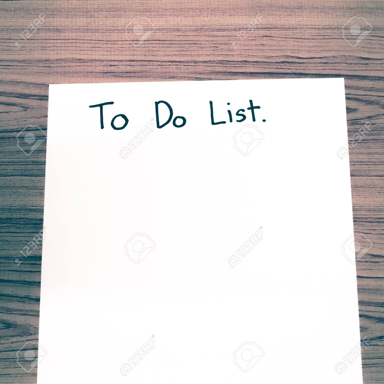 paper write to do list word on wood background vintage style stock