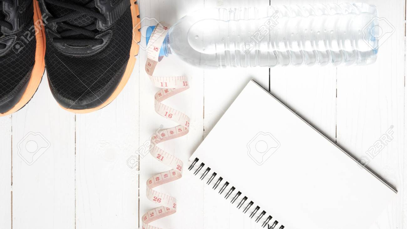 Running Shoesmeasuring Tapedrinking Water And Notebook On White Measuring Tape Diagram Wood Table Stock Photo