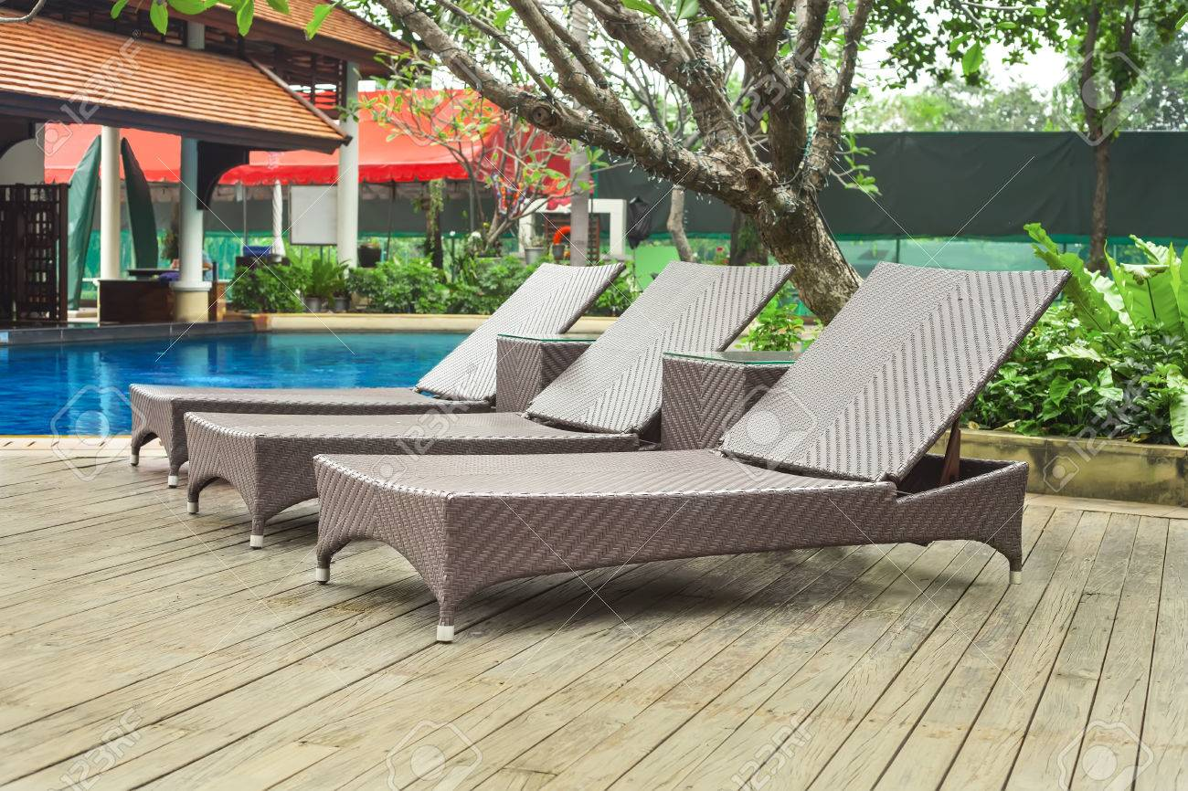 Poolside loungers at an exotic asian hotel. Stock Photo - 23043329