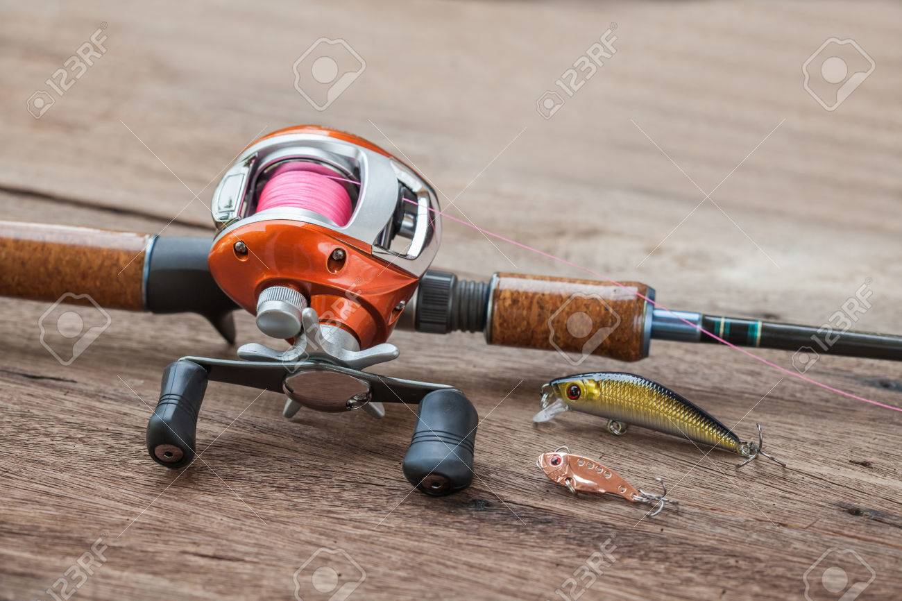 Fishing tackle - Baitcasting Reel, hooks and lureson wooden