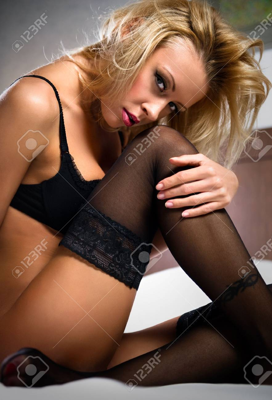 Blond seductive woman sitting in a bed Stock Photo - 8774193