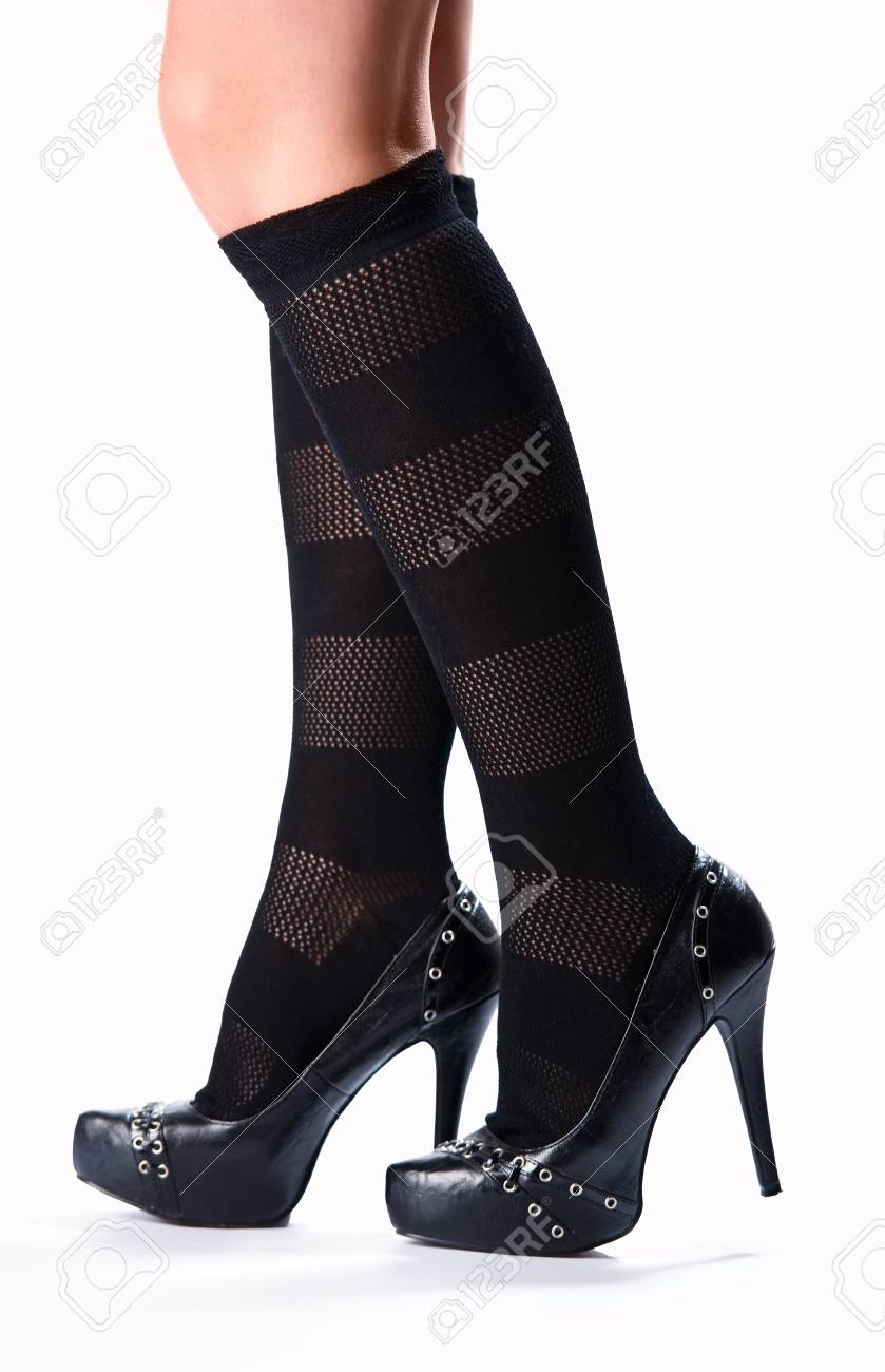 Beautiful female legs and high heels over white background Stock Photo - 9336629