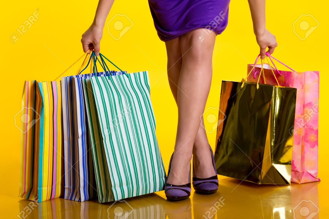 female hands holding shopping bags stock photo picture and