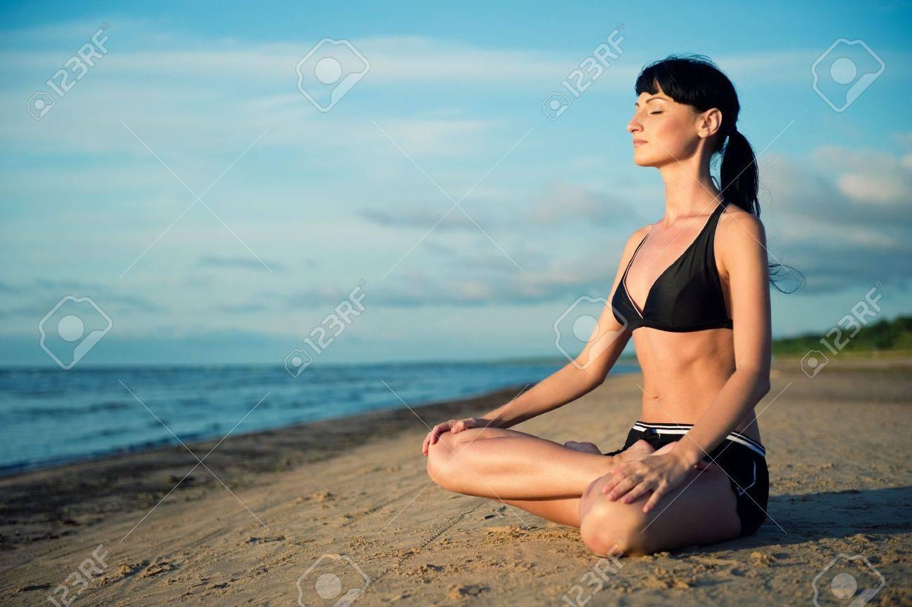 Woman doing yoga exercise outdoors Stock Photo - 10480569