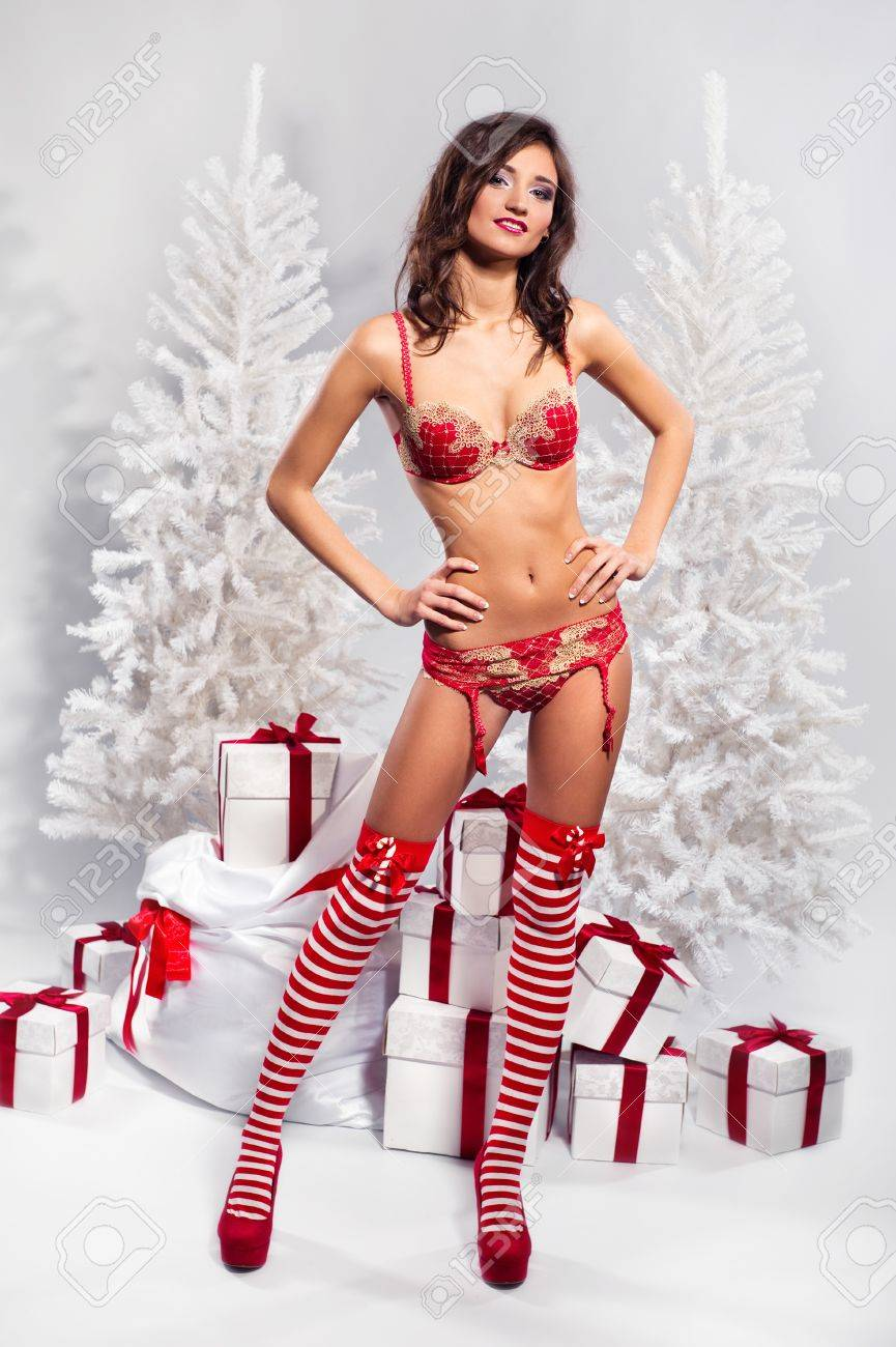 Christmas Lingerie.Beautiful Brunette Wearing Sexy Christmas Lingerie Posing Over