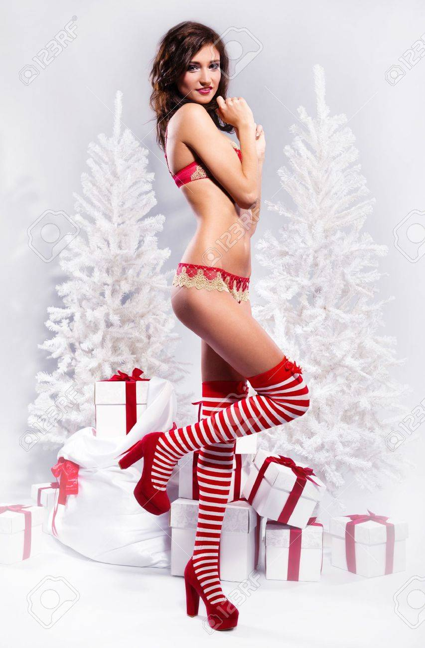 Beautiful brunette wearing sexy lingerie posing over christmas background Stock Photo - 11261037