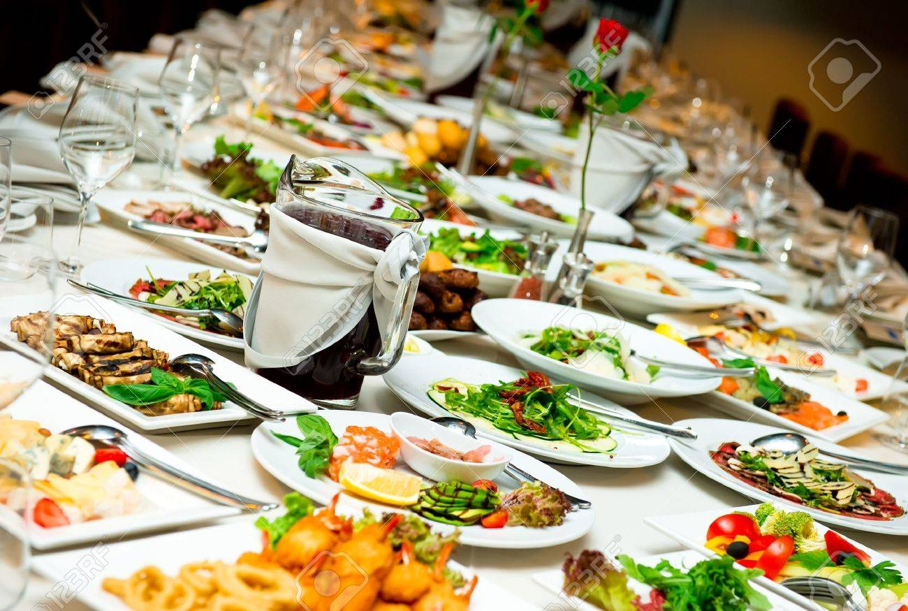 Dinner table with food - Table With Food And Drink Stock Photo 11594758