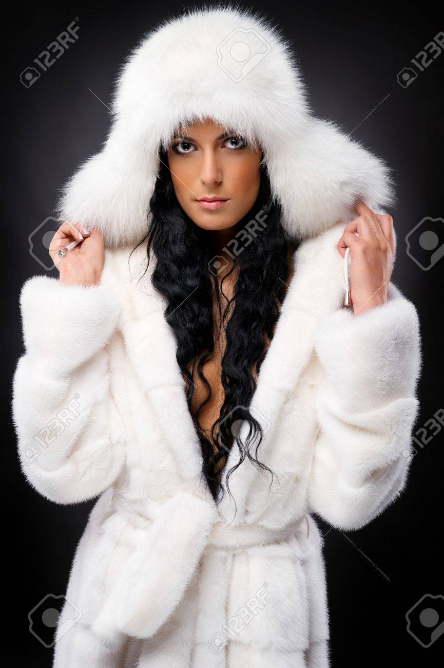 Beautiful woman in white fur coat and cap Stock Photo - 11958889