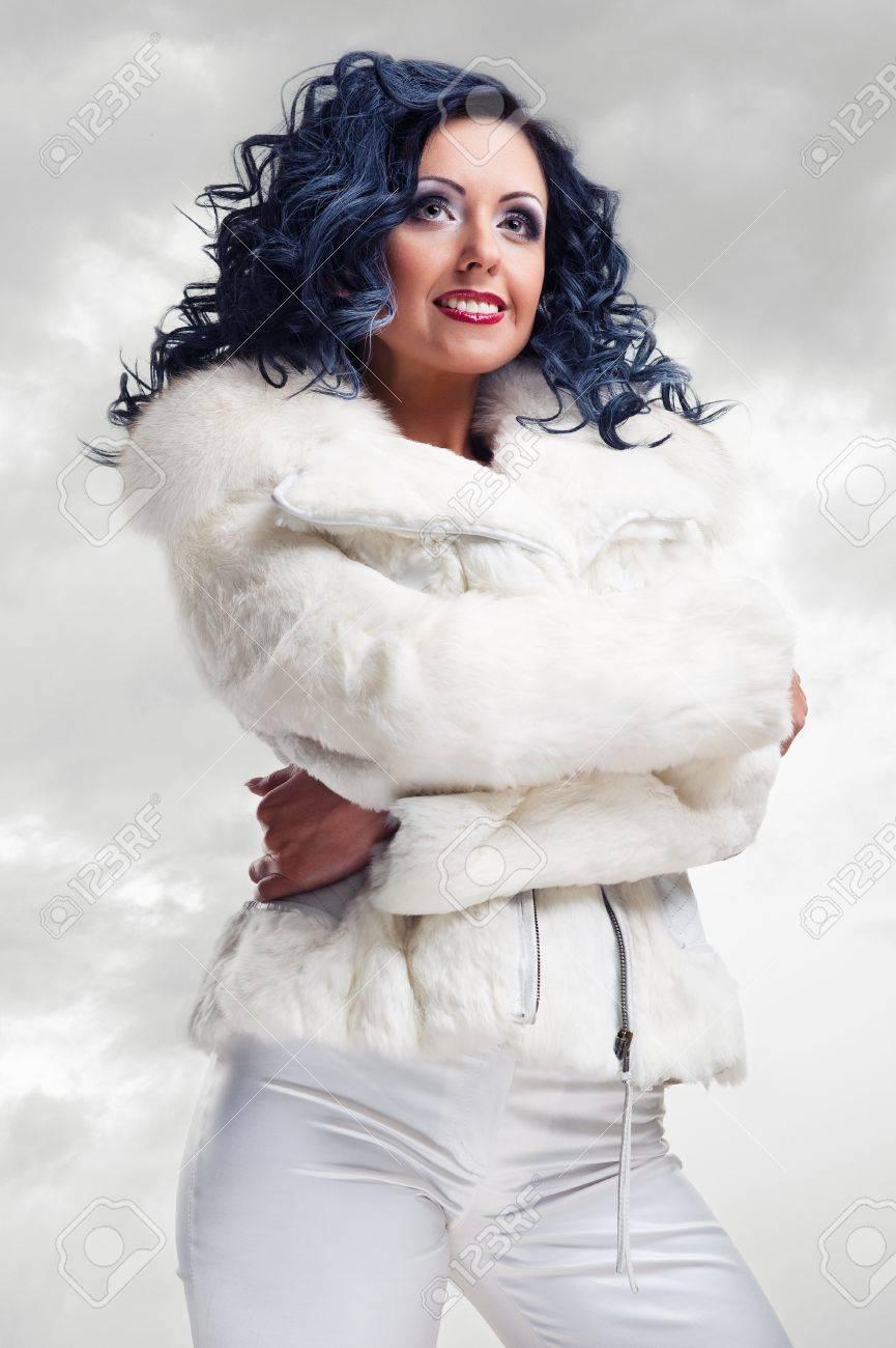 Beautiful brunette in white fur coat Stock Photo - 12407364