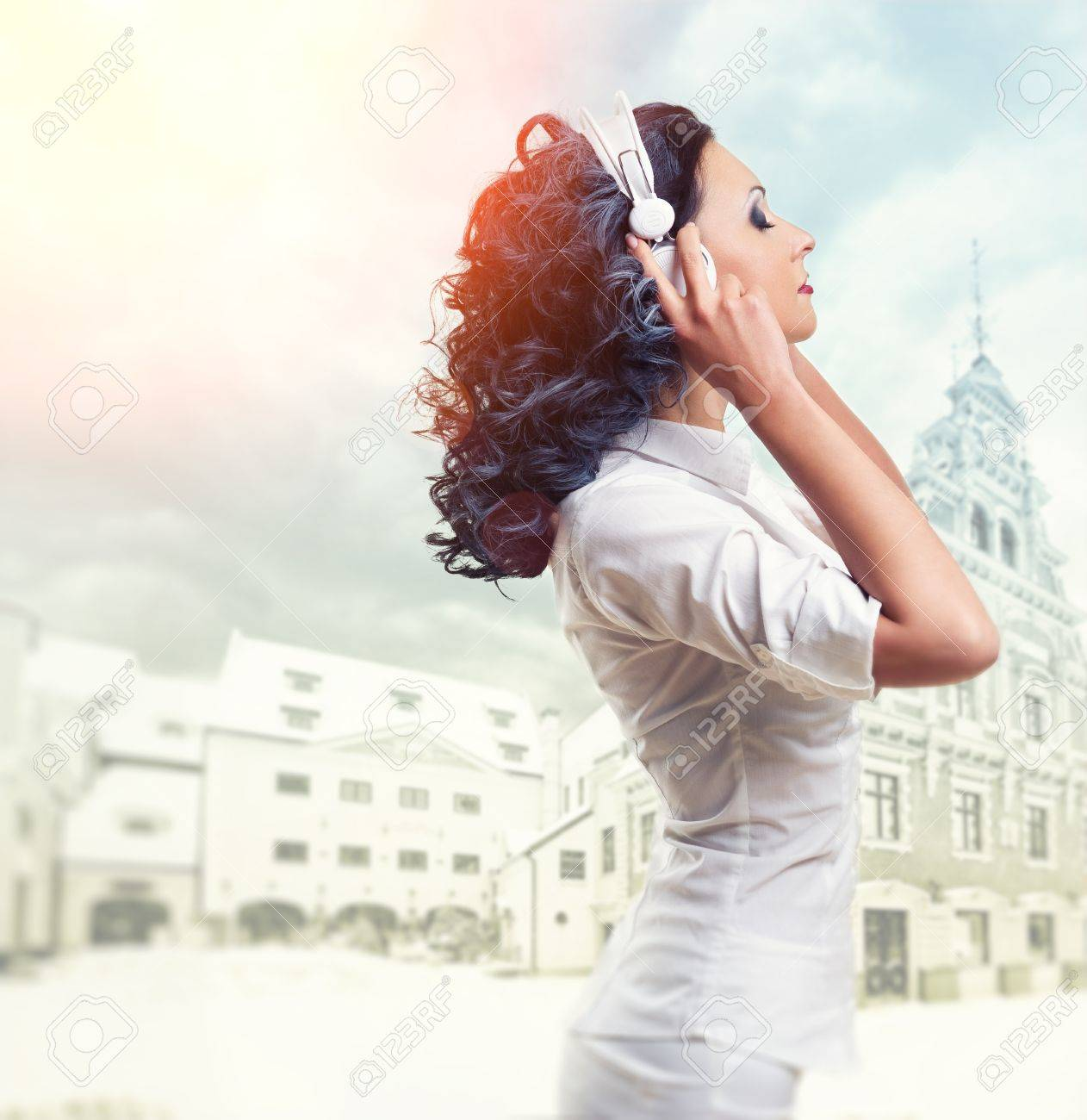 Beautiful woman listening music with headphones Stock Photo - 12666015