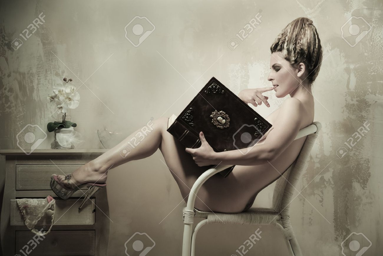 Naked girl and book