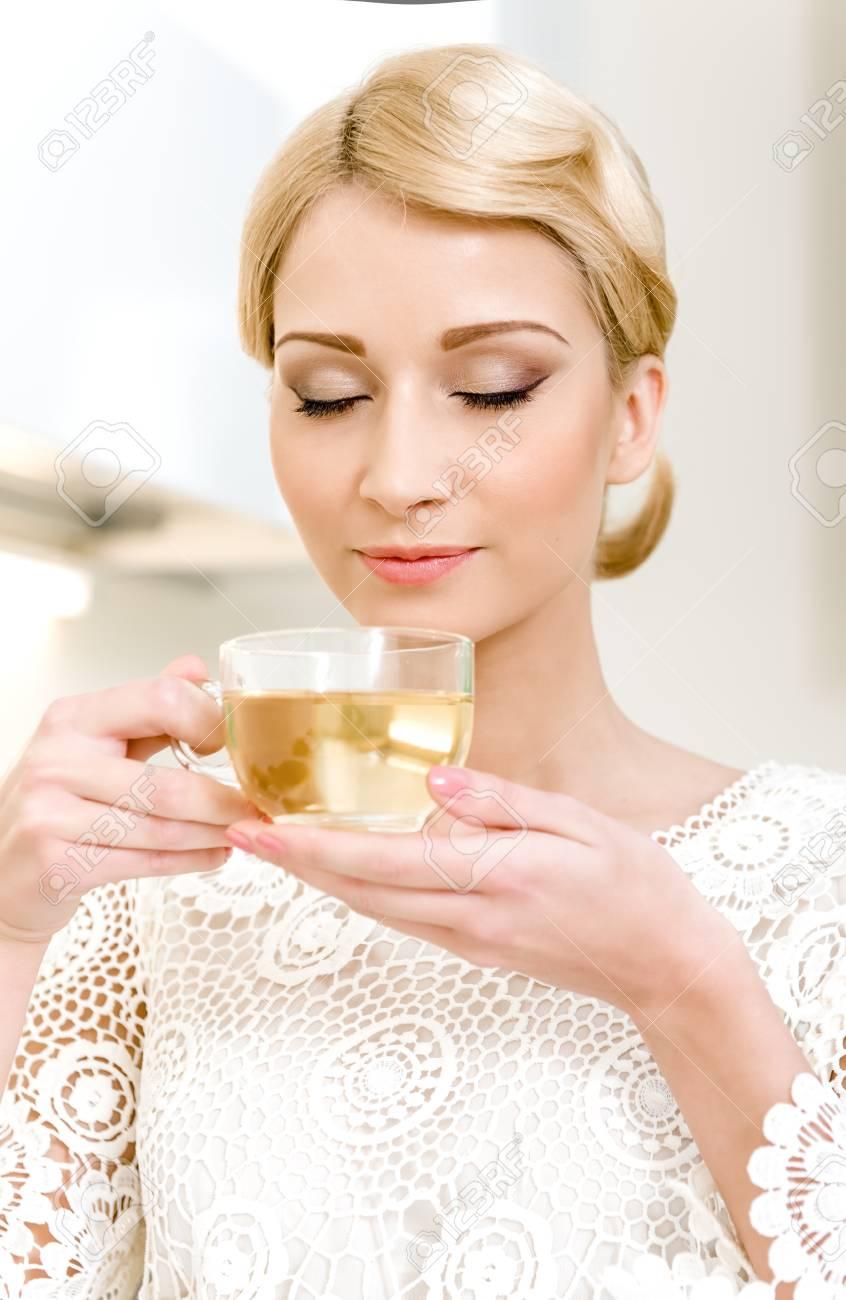 Portrait of beautiful girl drinking tea Stock Photo - 17482859