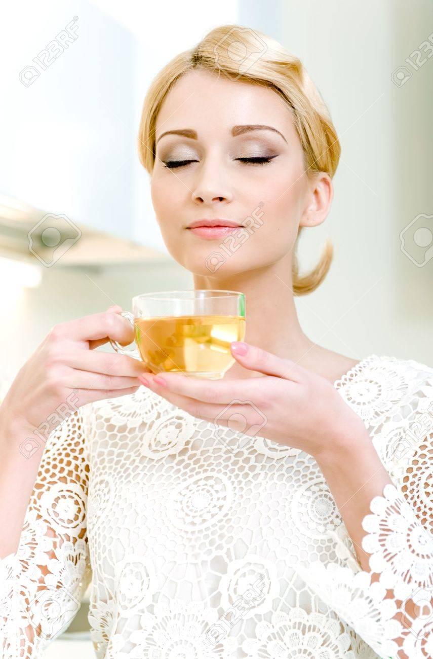Portrait of beautiful girl drinking tea Stock Photo - 17482857