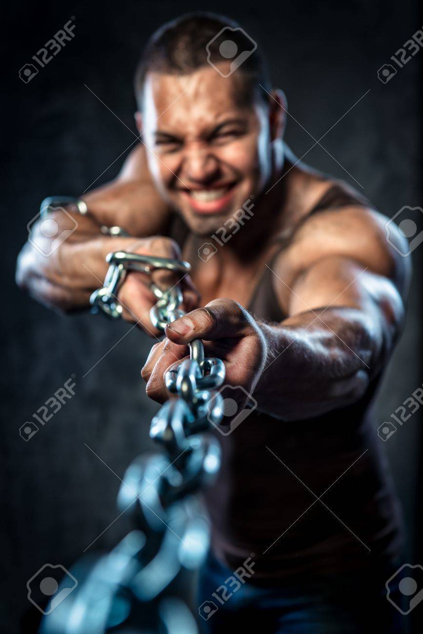 Muscular man pulling the chain Stock Photo - 20834465