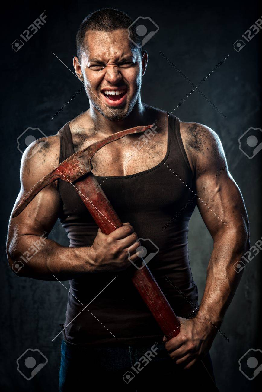 Muscular man holding pickaxe Stock Photo - 20825096