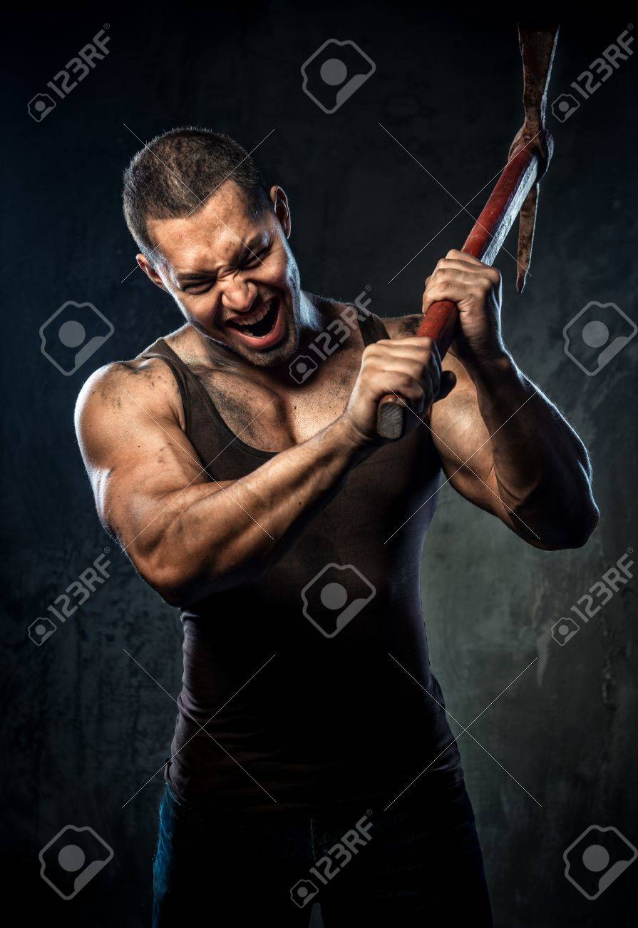 Muscular man holding pickaxe Stock Photo - 20825105