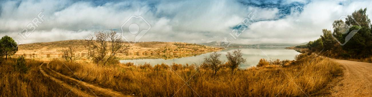 Panorama of beautiful winter landscape with lake and cloudy sky Stock Photo - 25311636