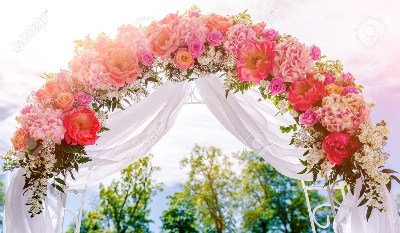 Beautiful white wedding arch decorated with pink and red flowers beautiful white wedding arch decorated with pink and red flowers outdoors stock photo 43471081 junglespirit Images