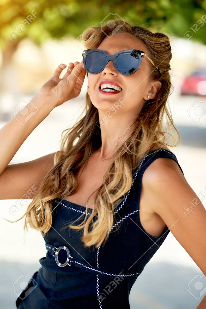 05ea2eecee Beautiful blonde woman with sunglasses posing outdoors Stock Photo -  85546750
