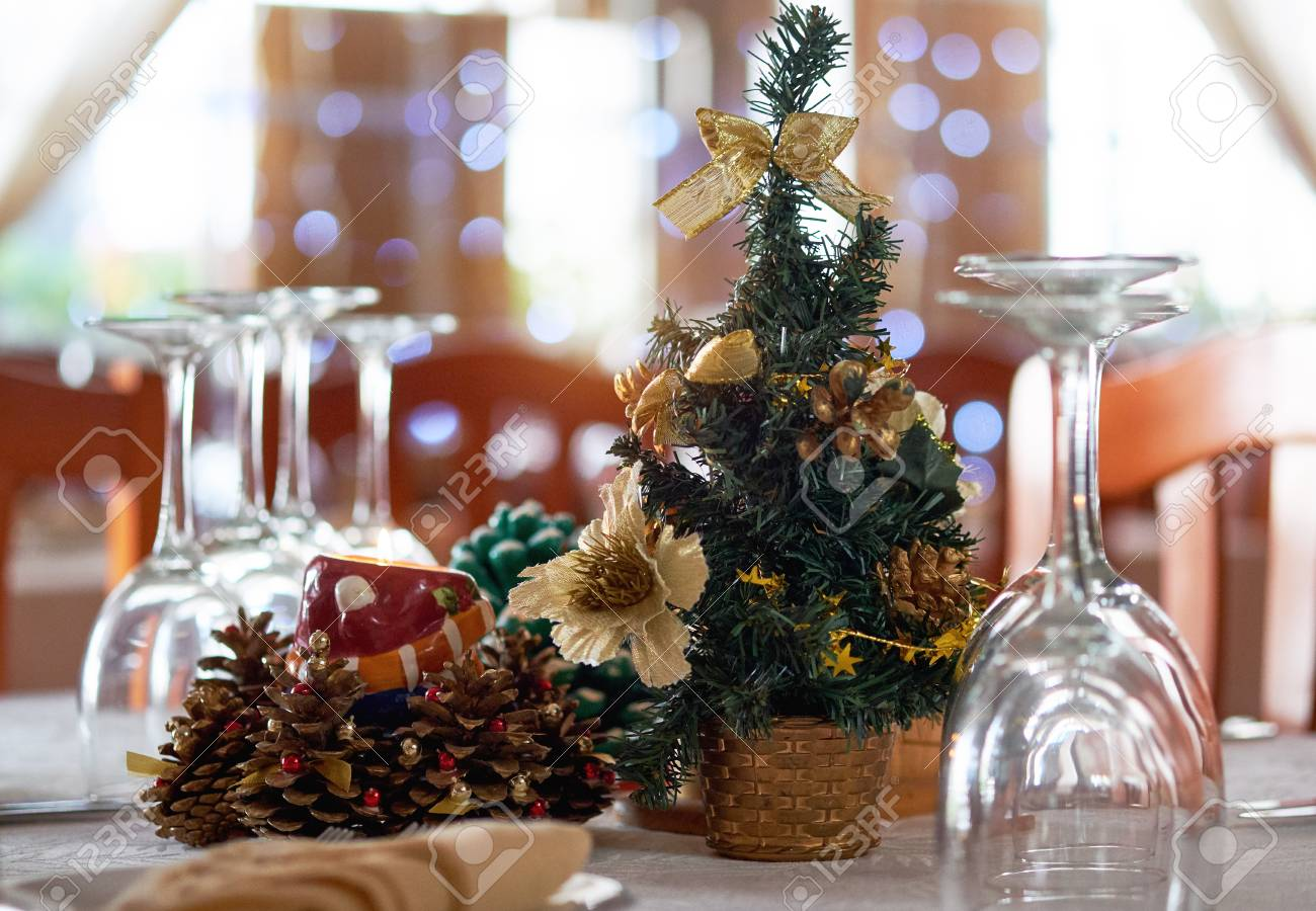 stock photo table setting with christmas decorations in a restaurant