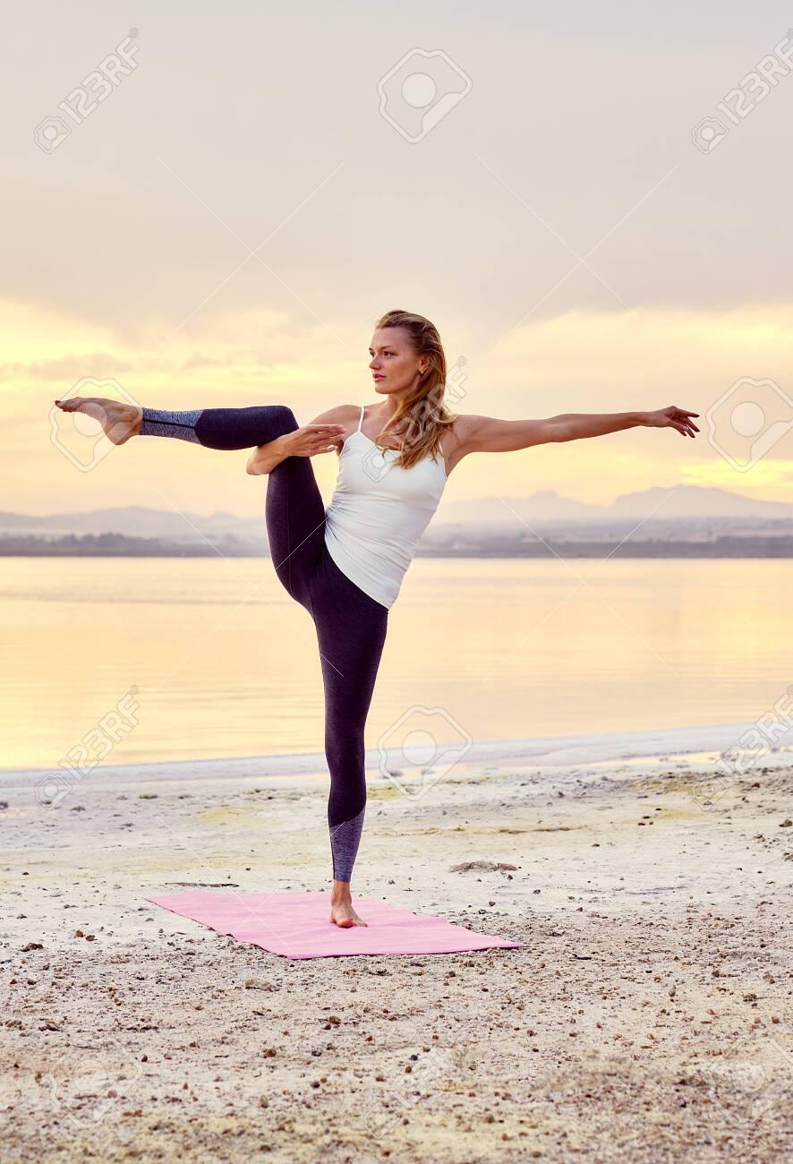 Yogi Woman In Activewear Do Balancing Yoga Pose, Stand On One Leg ...