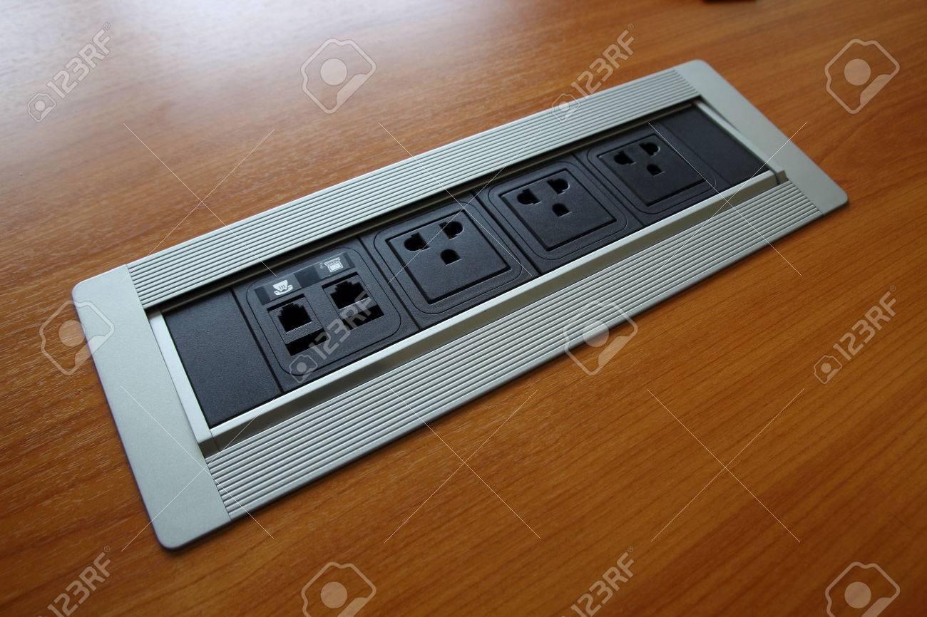 Electric Plug On The Conference Table Plugs Part Stock Photo - Conference table electrical sockets