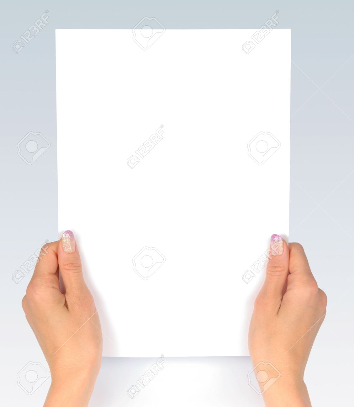 Female hands with clean sheet of paper Stock Photo - 5700911