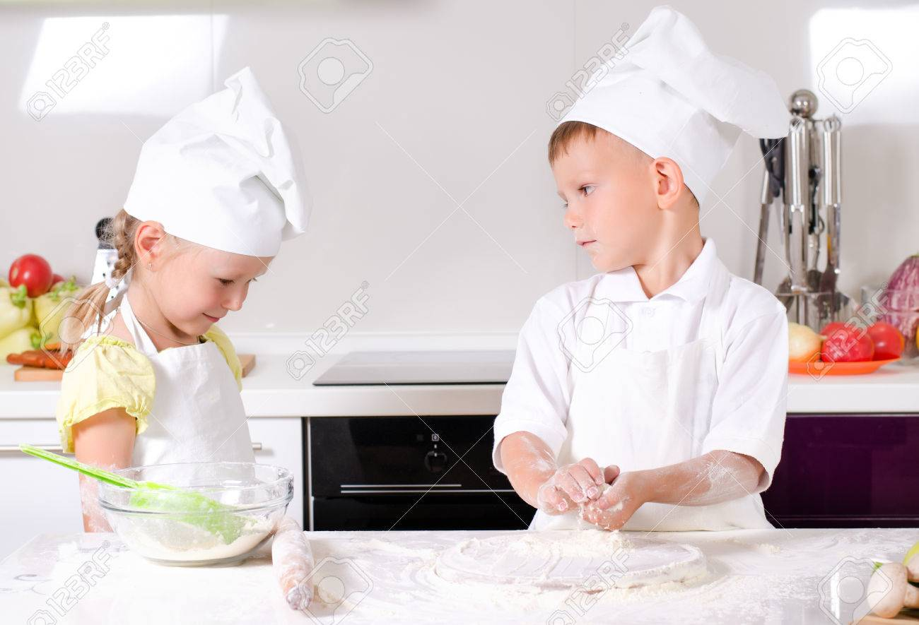 Arguments In The Kitchen With A Cute Little Girl In A Cooks Uniform ...