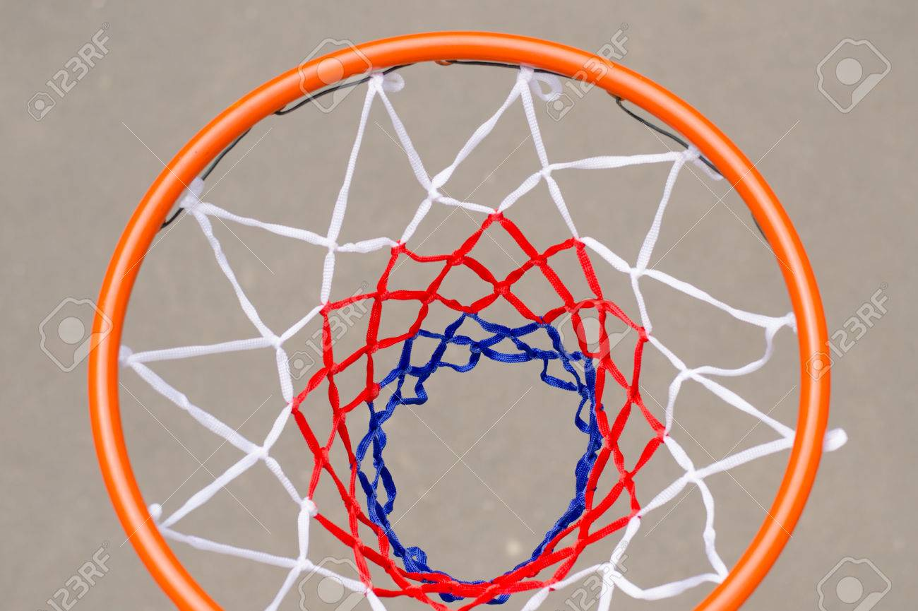 view from above of a basketball hoop with a new net suspended