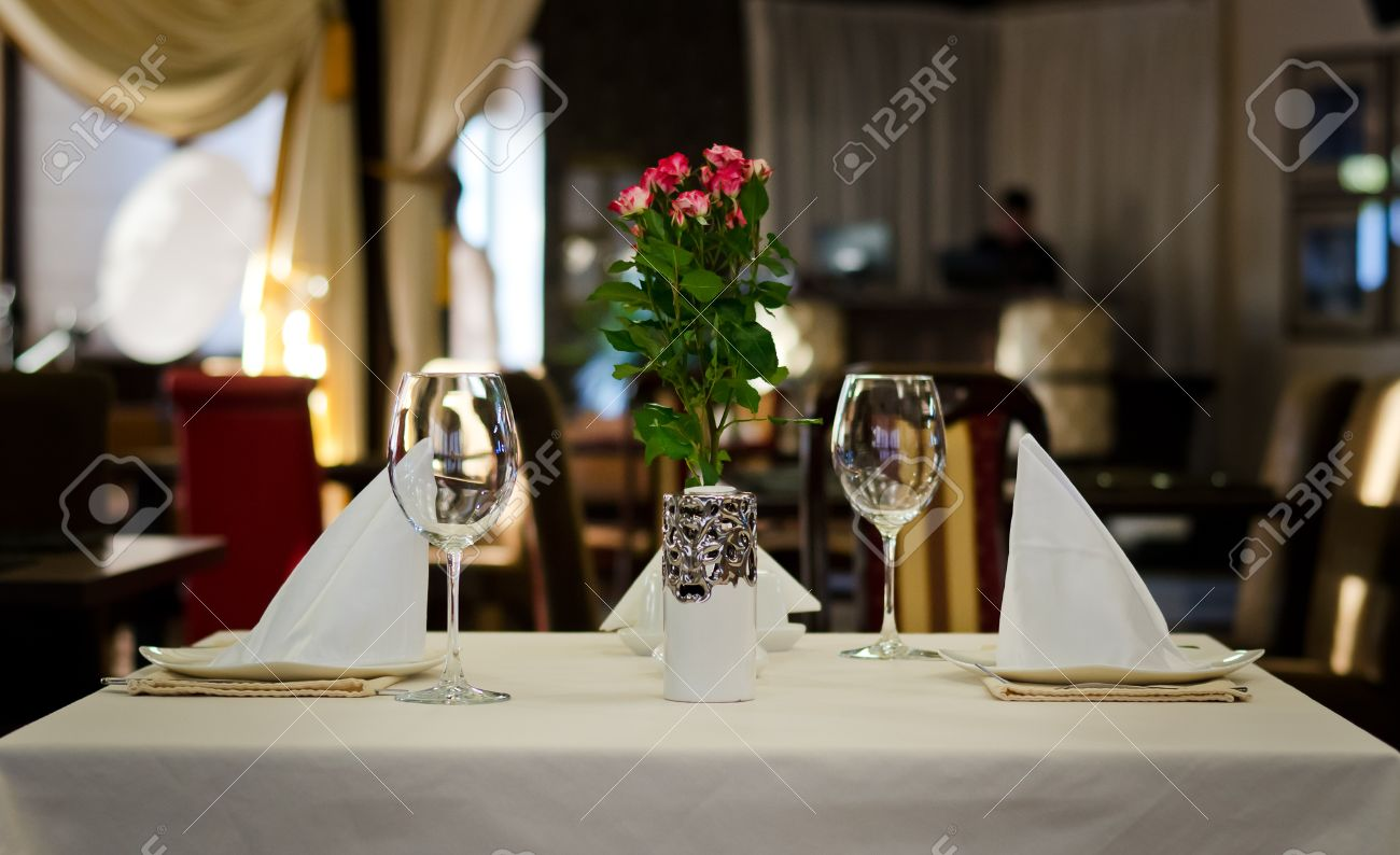 Restaurant table setting for two - Close Up Elegant Tabletop Setting Design For Two People Inside An Expensive Restaurant Stock Photo
