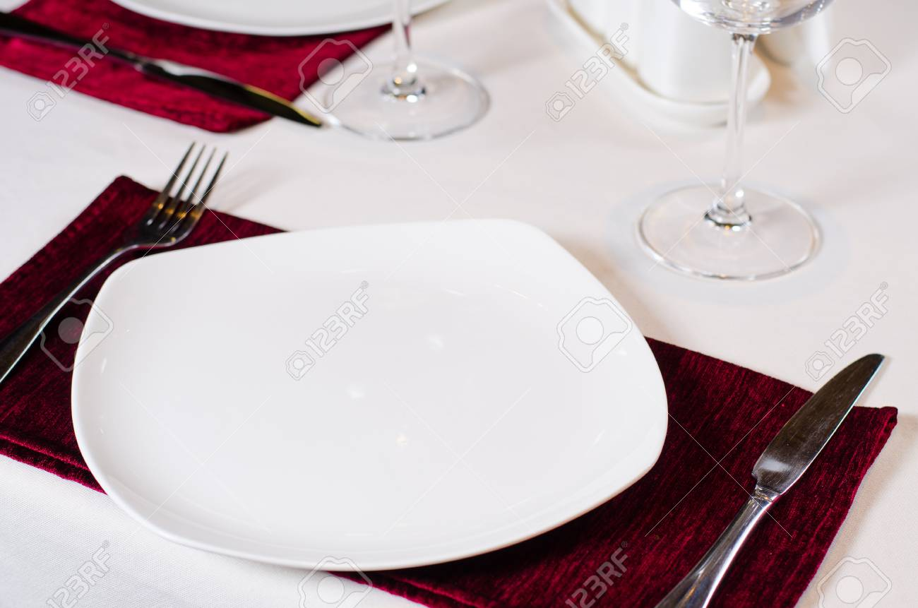 Place Setting In Fancy Restaurant With White Plate Red Placemat Stock Photo Picture And Royalty Free Image Image 33439963