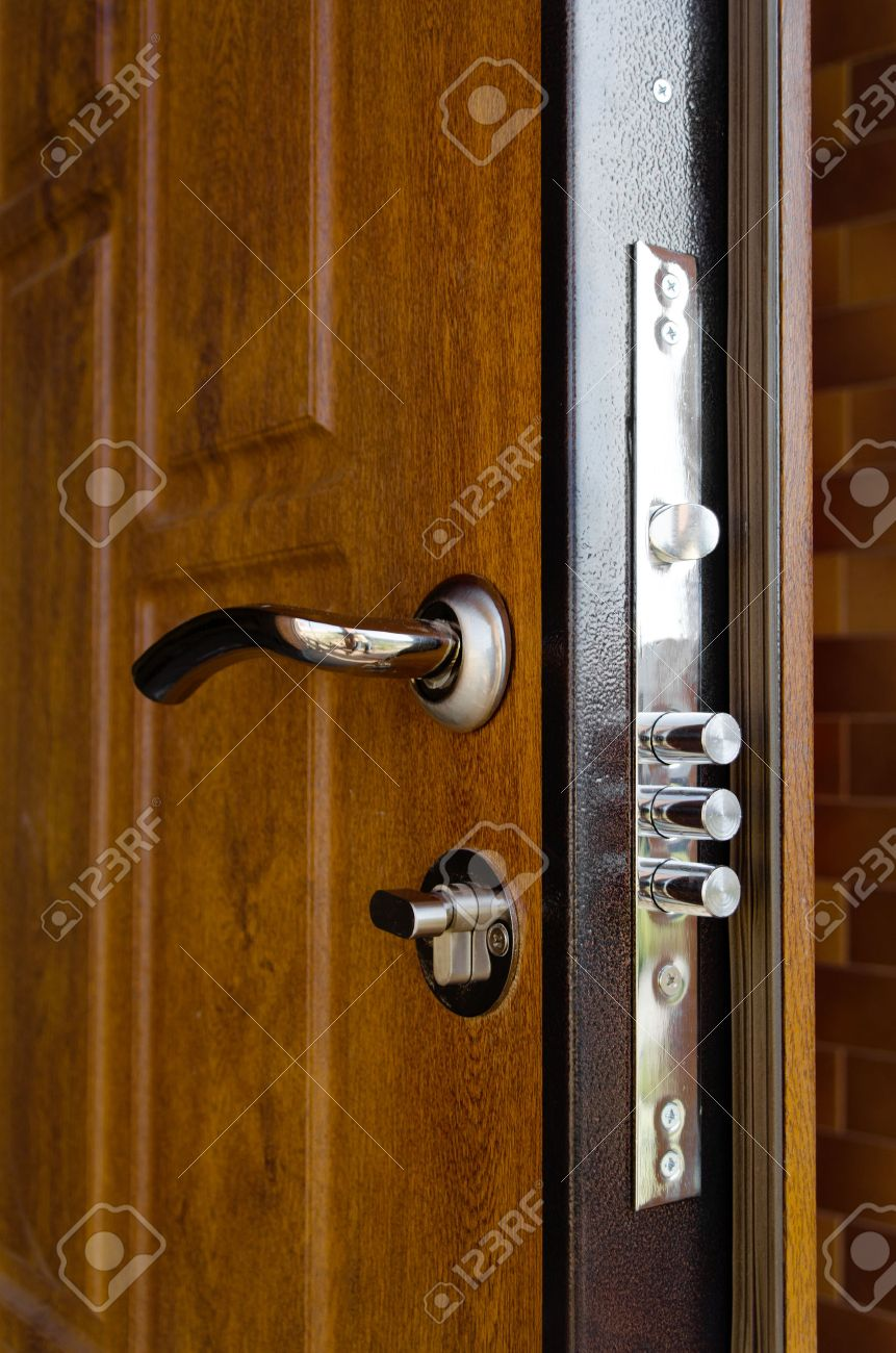 Triple Cylinders On A New High Security Lock Installed In A Wooden