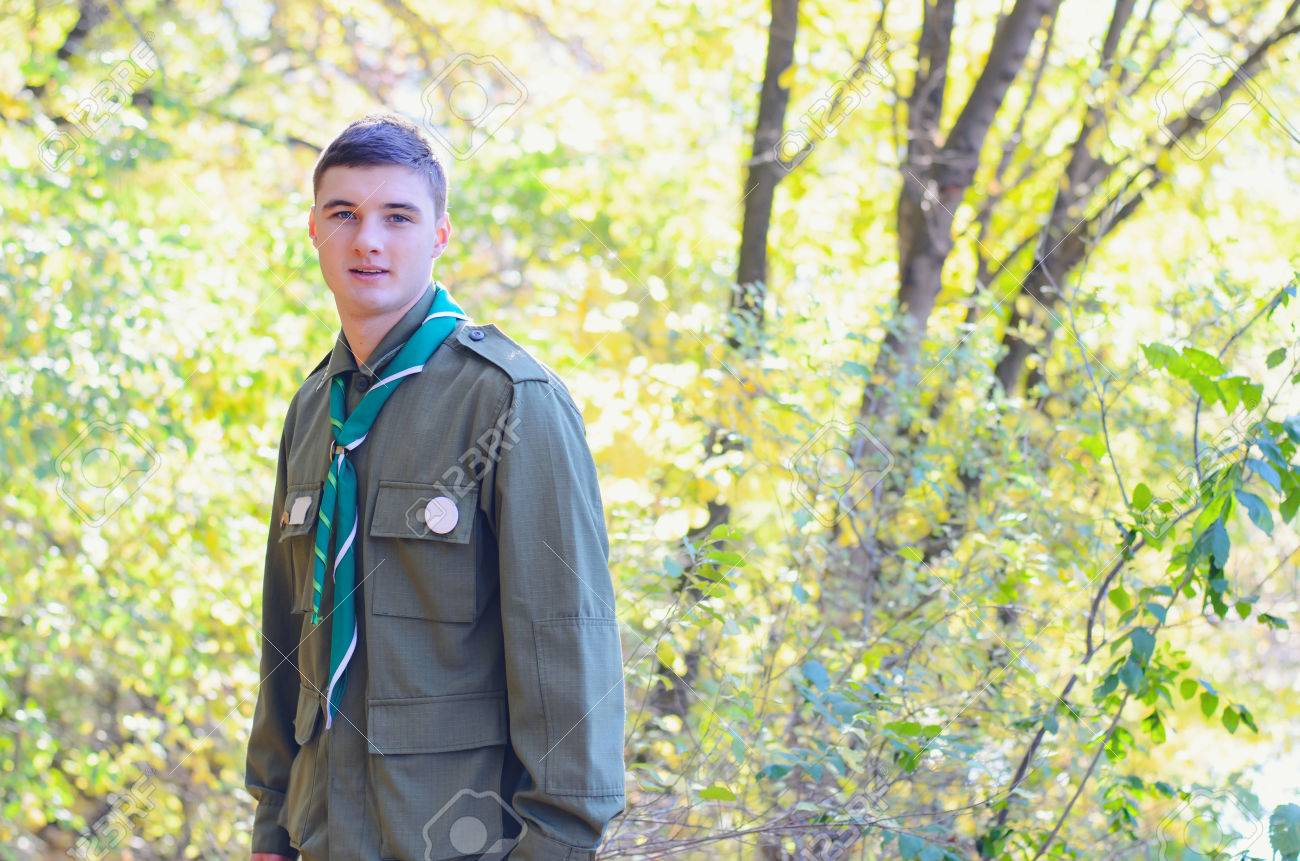 Waist Up Portrait of Boy Scout Wearing Uniform Standing in Forest on Sunny Day - 38260272