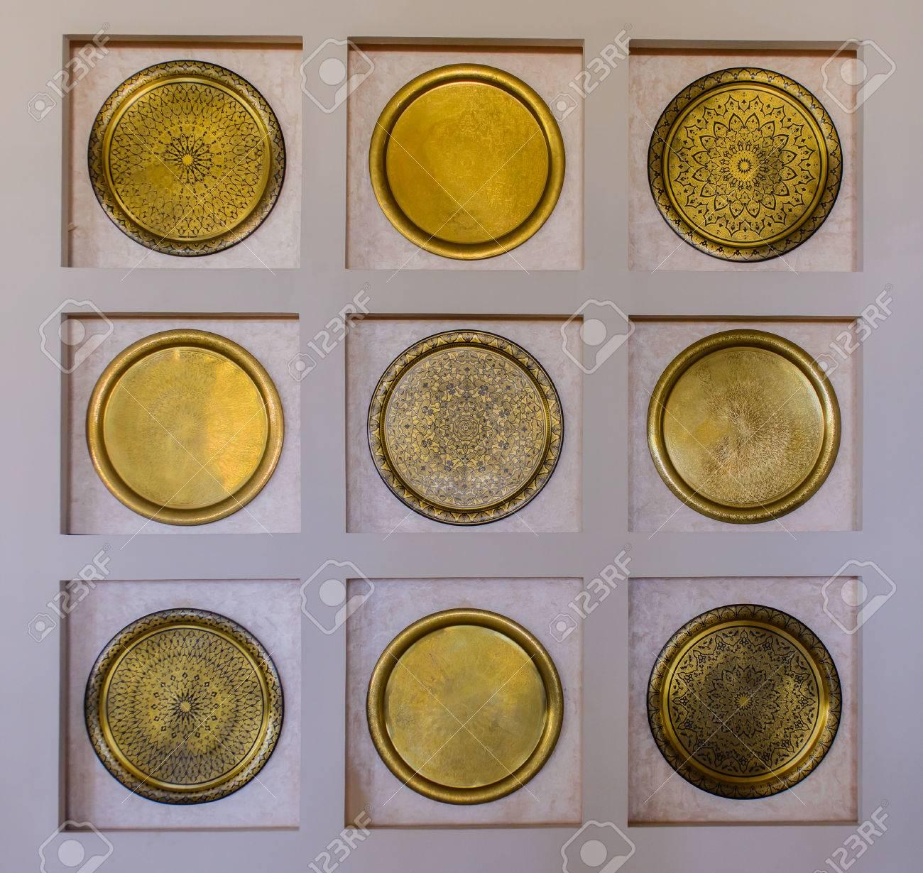 Interior Decor Of A Set Of Nine Ornate Round Brass Wall Plates