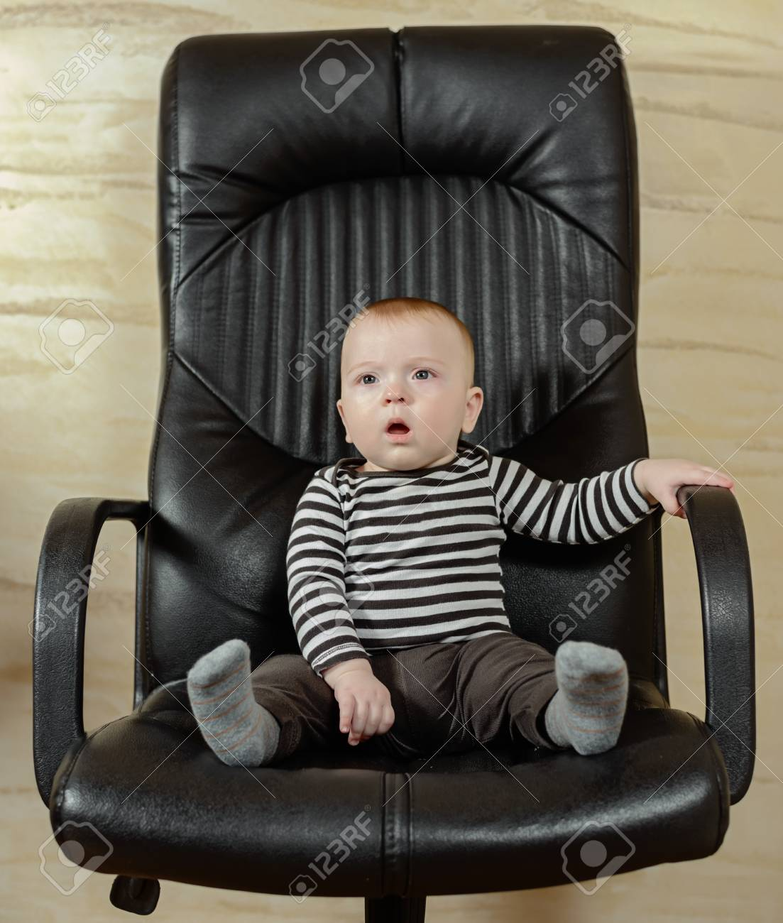 Strange Fun Portrait Of A Cute Chubby Little Baby Boy Sitting In A Black Interior Design Ideas Apansoteloinfo