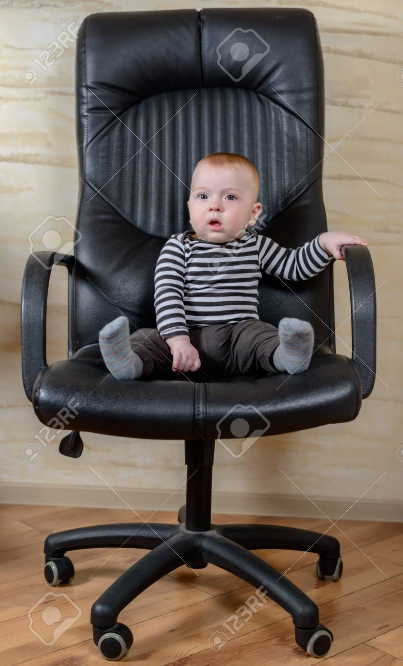 Surprising Fun Portrait Of A Cute Chubby Little Baby Boy Sitting In A Black Interior Design Ideas Apansoteloinfo