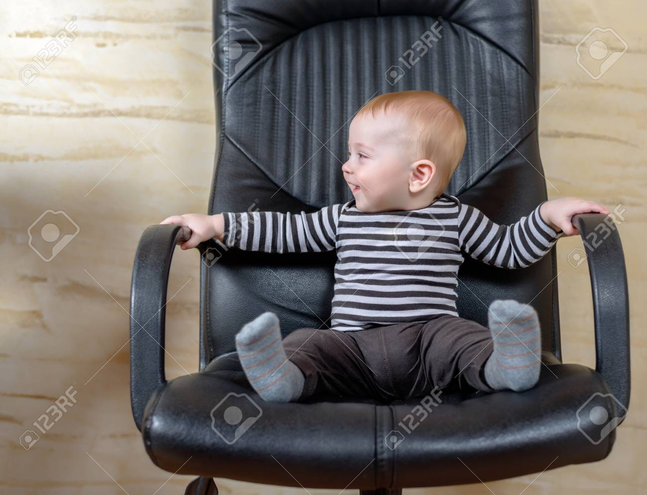 Amazing Fun Portrait Of A Cute Chubby Little Baby Boy Sitting In A Black Interior Design Ideas Apansoteloinfo