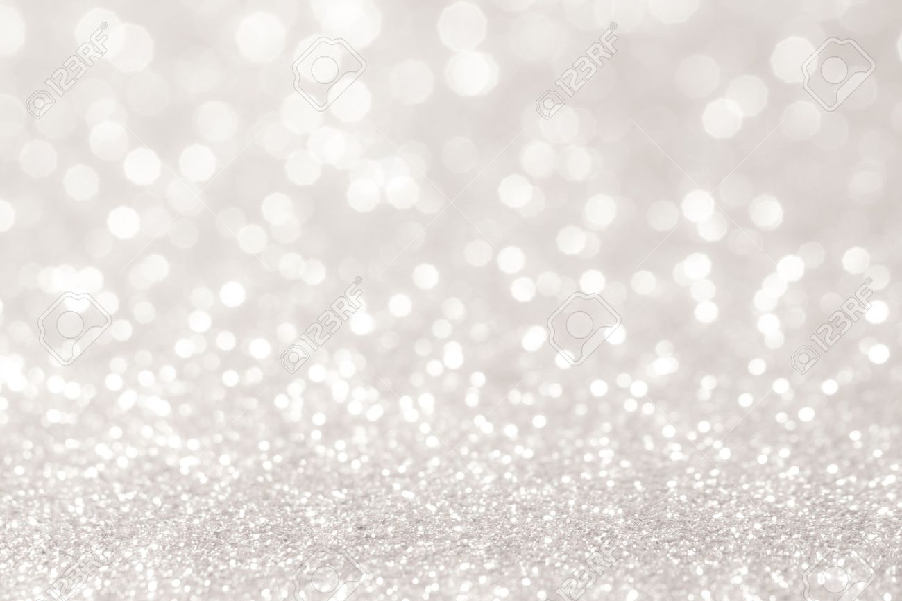 silver and white bokeh lights defocused. abstract background stock