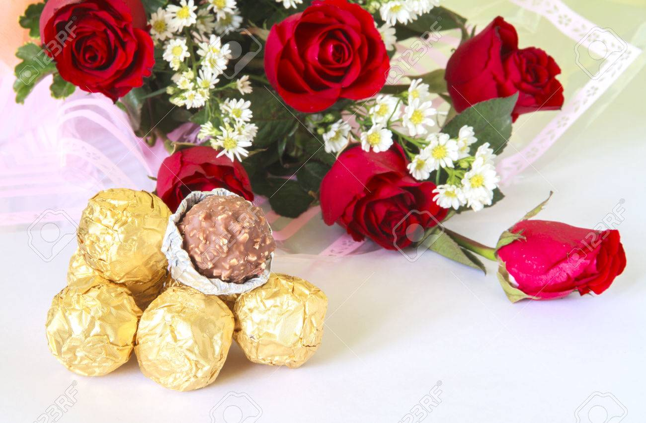 Red Rose Flower Bouquet With Chocolate Ball Isolated On White ...