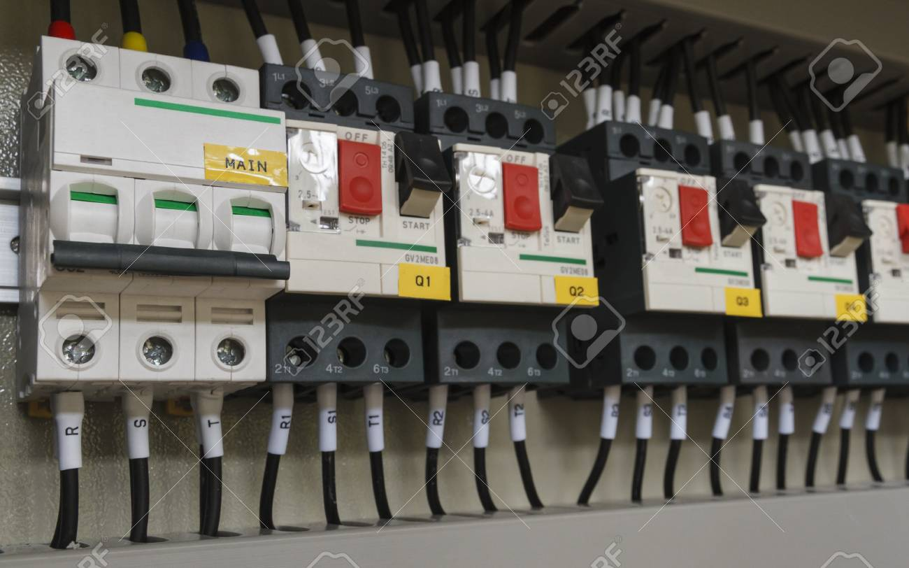 Close Up Electrical Wiring With Fuses And Contactors Control Panel Of Automatic Machine