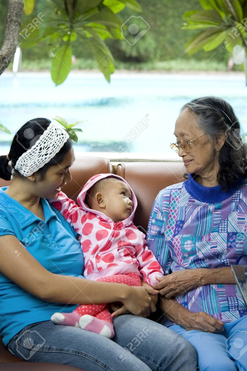 photo of 3 generation women: a baby, mom and grandma having a good time together - togetherness Stock Photo - 4147563