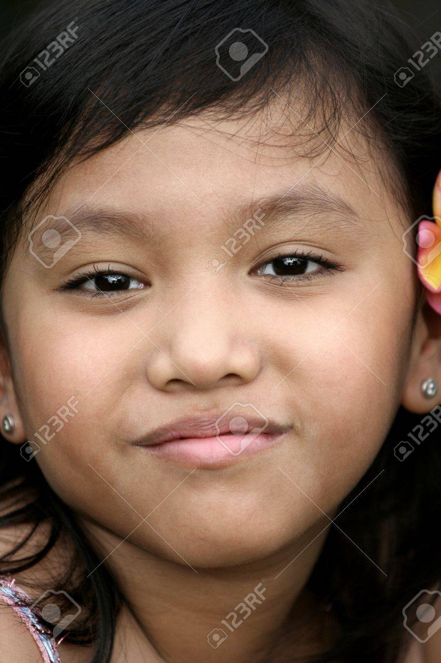 close up face of asian little girl with a sweet smile Stock Photo - 4307242