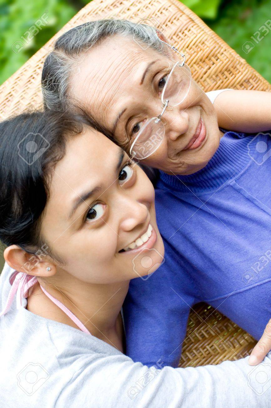 family portrait of 2 happy generation woman posing together - relationship Stock Photo - 4756523