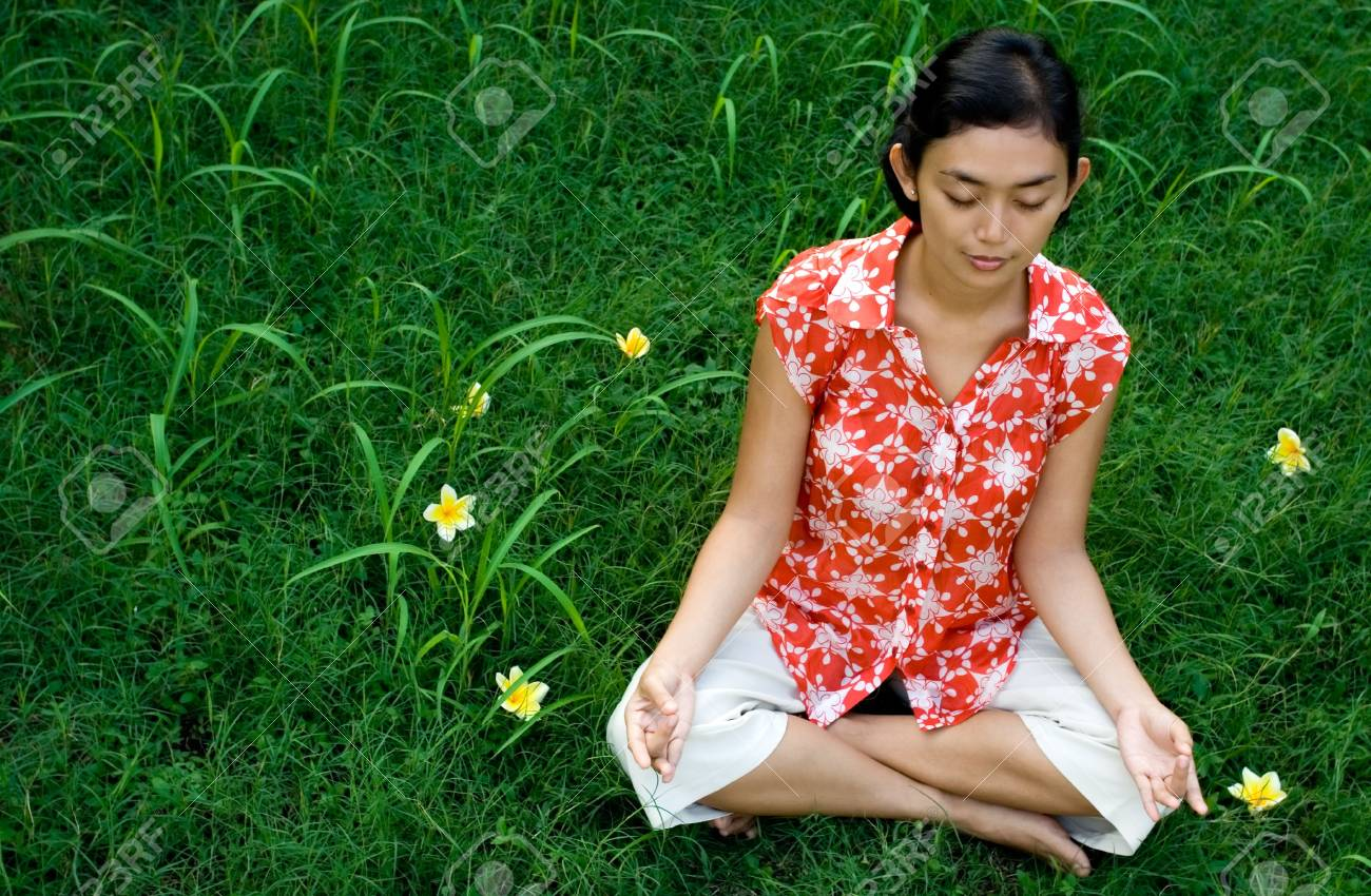 pretty asian woman meditating in natural environment, surrounding with green grass Stock Photo - 5012491